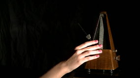 View of metronome sets rhythm. Musician slows it stock video footage