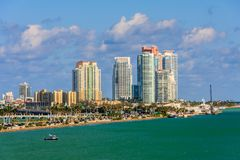 View of Miami from Cruise Terminal. Miami - View 1  from Cruise Ship Port Terminal. Sky scrappers, blue greenish water and blue sky with clouds Stock Images
