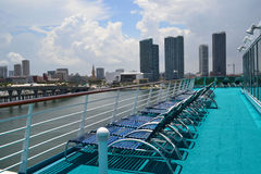 View of Miami. Empty deck chairs awaiting cruisers on a fun filled vacation Royalty Free Stock Photography