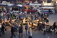 View of the mid section of the Foodfestival. Amsterdam, the Netherlands - November 29, 2015: Visitors at the Crepesmobiel, the Deli Lama and the Scropp food Stock Images