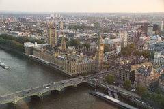 View from the middle air from London Eye on the London Architecture. View from the top of the London Eye on Palace of Westminster and Big Ben. Horizontal image Royalty Free Stock Images
