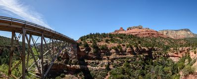 View at Midgley Bridge over Oak Creek Canyon. Steel Midgley Bridge  over Oak Creek Canyon Sedona Arizona, USA. Green plants and trees on the background Stock Photos