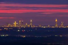 View of Midtown Atlanta fron Stone Mountain, Georgia, USA. The beautiful view of illuminated Midtown Atlanta from the Stone Mountain at twilight with red sky Stock Photography