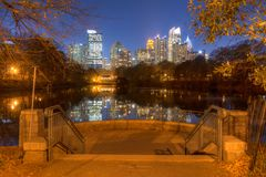 Midtown Atlanta and Piedmont Park, USA. View of Midtown Atlanta from the Skyline Picture Point in Piedmont Park at dusk, USA Royalty Free Stock Image