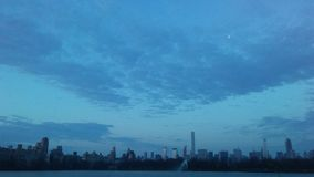 View of Midtown Manhattan Skyline from Central Park during Sunrise on Easter Sunday in New York, NY. Royalty Free Stock Photos