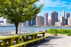 The midtown Manhattan skyline on a beautiful summer day Royalty Free Stock Images
