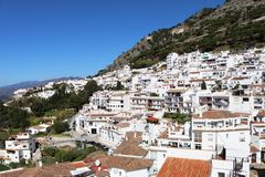 Mija Pueblo white village in Spain, Andalucia. A view of Mijas Pueblo in Spain with the Sierra Mijas mountains in the background stock photo