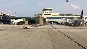 View of Milan-Malpensa airport Terminal 1 from the moving aircraft. stock video
