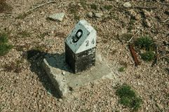 View of milestone made of concrete. On ground with gravel, in the highlands of the Serra da Estrela. The highest mountain range in continental Portugal, with stock images