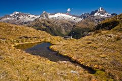 View of Milford range from Routeburn track in New Zealand. Harris Lake from the valley of Routeburn track in New Zealand, Lonely planet guide, natural beauty royalty free stock image