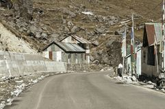 View of Military camp on highway road side to Nathula Pass of India China border near Nathu La mountain pass in the Himalayas. View of Military camp on a highway royalty free stock photography
