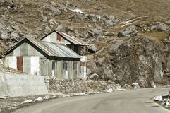 View of Military camp on a highway road side to Nathula Pass of India China border near Nathu La mountain pass in the Himalayas. View of Military camp on a stock images