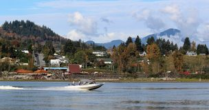 View of Mill at Hatzic from Southside of Fraser River. A scenic autumn view of a forest products mill area at Hatzic BC as viewed from the south side of the Stock Photos