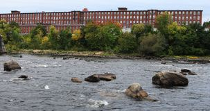 View of Mills along the Merrimack River Manchester, New Hampshire 4K. A View of Mills along the Merrimack River Manchester, New Hampshire 4K stock footage