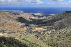 Valley and coast of ocean,  Lanzarote, Canary Islands, Spain Royalty Free Stock Photo