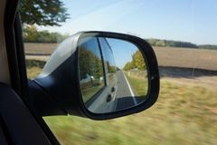 View into the mirror in a car. While driving Royalty Free Stock Photos