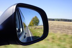 View into the mirror in a car. While driving Stock Image