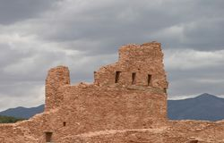 Mission with Cloudy backdrop, Abo Pueblo, New Mexico Royalty Free Stock Image
