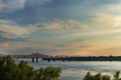 View of the Mississippi River with the Vicksburg Bridge on the background at sunset. Concept for travel in the USA and visit Mississippi royalty free stock photography