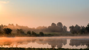 View of a misty bog. Mist, illuminated by the sun rising, drifts above a bog royalty free stock photo