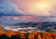 View of misty fog mountains in autumn, Carpathians, Ukraine Stock Photography