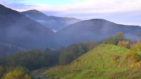 View of misty fog mountains in autumn, Carpathians, Ukraine stock video