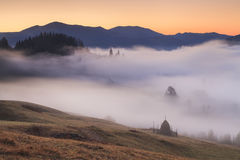 View of misty fog mountains , Carpathians Royalty Free Stock Photo