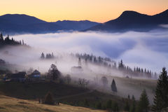 View of misty fog mountains Stock Photos