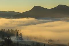 View of misty fog mountains , Carpathians Stock Image