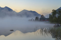 View of the misty mountain lake. Stock Photo