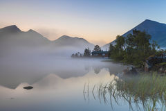 View of the misty mountain lake. Stock Photography
