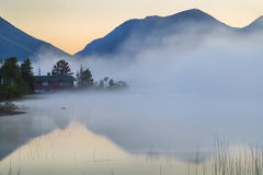 View of the misty mountain lake. Royalty Free Stock Image