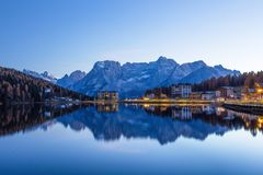 View of Misurina lake just after sunset. Sorapiss mountain on the background. Dolomites, Italy. View of Misurina lake just after sunset. Sorapiss mountain on Royalty Free Stock Photography