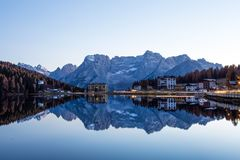 View of Misurina lake just after sunset. Sorapiss mountain on the background. Dolomites, Italy. View of Misurina lake just after sunset. Sorapiss mountain on stock image