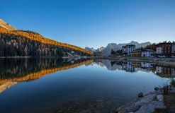 View of Misurina lake just after sunset. Sorapiss mountain on the background. Dolomites, Italy. View of Misurina lake just after sunset. Sorapiss mountain on Stock Images
