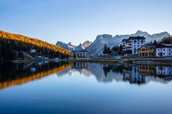 View of Misurina lake just after sunset. Sorapiss mountain on the background. Dolomites, Italy. View of Misurina lake just after sunset. Sorapiss mountain on royalty free stock images