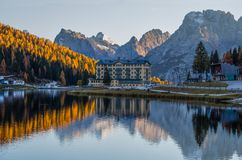 View of Misurina lake just after sunset. Sorapiss mountain on the background. Dolomites, Italy. royalty free stock images
