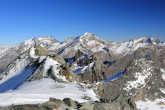 View from Mittelallalin Station. Overlooking glaciers and the highest peaks of the Swiss Alps. Stock Photography