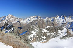 View from Mittelallalin Station. Overlooking glaciers and the highest peaks of the Swiss Alps. Royalty Free Stock Photography