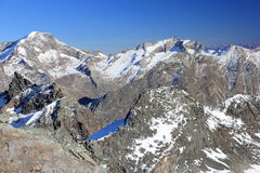View from Mittelallalin Station. Overlooking glaciers and the highest peaks of the Swiss Alps. Royalty Free Stock Image