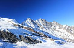 View from Mittelallalin Station. Overlooking glaciers and the highest peaks of the Swiss Alps. Stock Photo