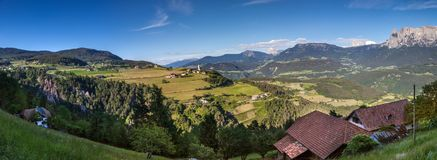 View of Mittelberg with earth pyramids. View of Mittelberg am Ritten, in the foreground the earth pyramids of Klobenstein, South Tyrol, Italy royalty free stock images