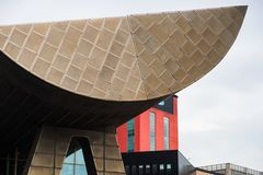 View of modern architectural buildings at the Lowry waterside arts complex at the Salford Quays. Manchester, United Kingdom - April 24, 2019: View of modern royalty free stock image