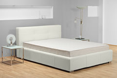 A view of a modern bed. In a bedroom Royalty Free Stock Photo