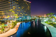 View of a modern building and Rainbow Lagoon Park at night  Royalty Free Stock Image