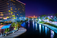 View of a modern building and Rainbow Lagoon Park at night  Stock Photography