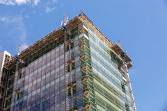 View of a modern building under construction. On a sunny summer day Royalty Free Stock Photography