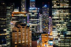 View of modern buildings along Simcoe Street at night, in the Fi Stock Image