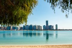 View of modern buildings from the canal shore in Abu Dhabi royalty free stock image