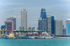 View of modern and busy Singapore Tanjong Pagar PSA ports serving cargo ships. SINGAPORE - JANUARY 26: View of modern and busy Singapore Tanjong Pagar PSA ports stock images